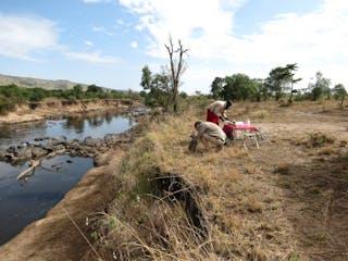Setting Up Bush Breakfast By The Mara River