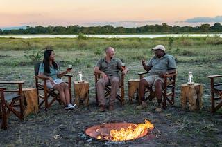 Enjoying A Campfire At Kuthengo Camp