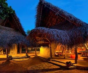 Family Huts At The Mudhouse At Night