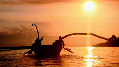 Fishermen On Lake Kivu At Sunset