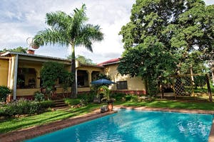 Heuglins Lodge Swimming Pool And Lush Gardens