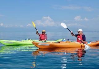 Kayaking On The Blue Waters Of Lake Kivu