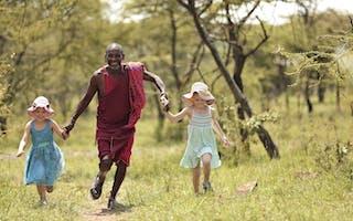 Naboisho Camp Guide And Children Running