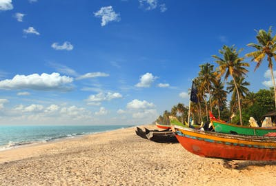Sand Sea And Boats In Kerala