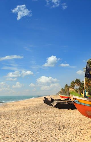 Sand Sea And Boats In Kerala