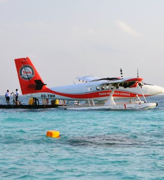 Seaplane At Jetty In The Lagoon