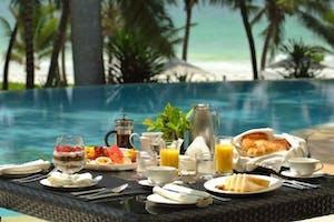 Poolside Dining At The  Almanara  Luxury  Boutique  Hotel  Villas