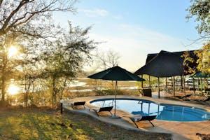 Muchenje Safari Lodge Pool At Sunset