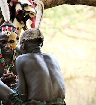 Ethiopia Omo Valley Karo Men Sitting
