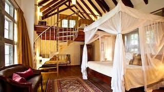 Giraffe Manor Master Bedroom